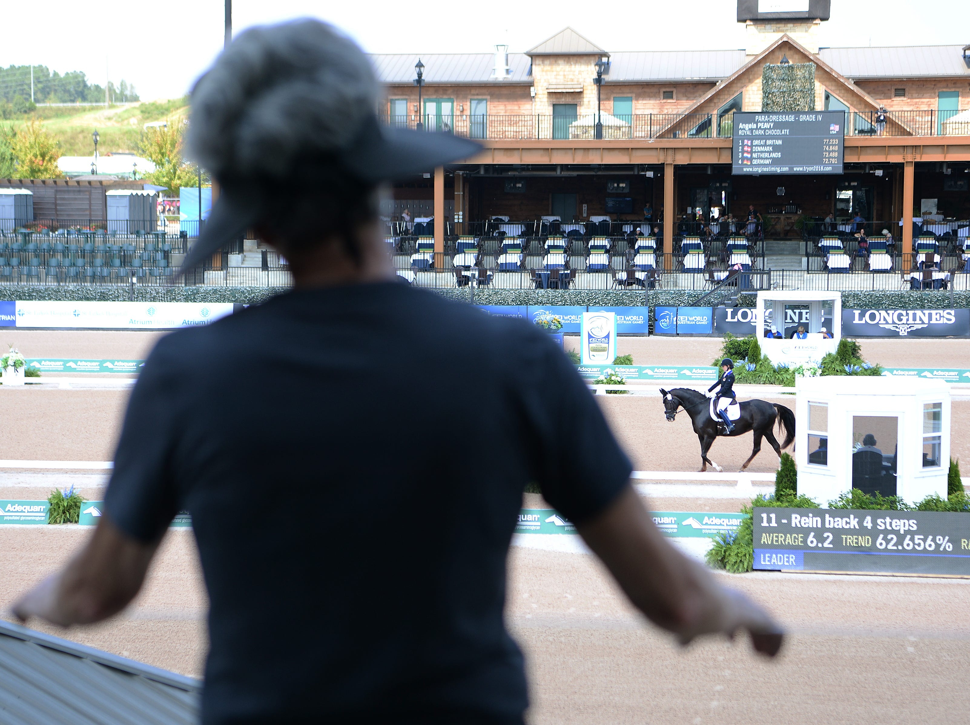 Marlene Whitaker, of Fairview, watches American Angela Peavy perform in the Para-dressage event of the FEI World Equestrian Games at the Tryon International Equestrian Center on Sept. 20, 2018. Whitaker created the choreography for Peavy's freestyle competition.