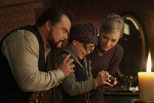 """This image released by Universal Pictures shows Jack Black, from left, Owen Vaccaro and Cate Blanchett in a scene from """"The House With A Clock in Its Walls.""""  (Quantrell D. Colbert/Universal Pictures via AP)"""