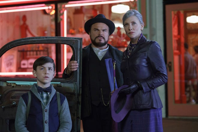 """This image released by Universal Pictures shows Owen Vaccaro, from left, Jack Black and Cate Blanchett in a scene from """"The House With A Clock in Its Walls.""""  (Quantrell D. Colbert/Universal Pictures via AP)"""