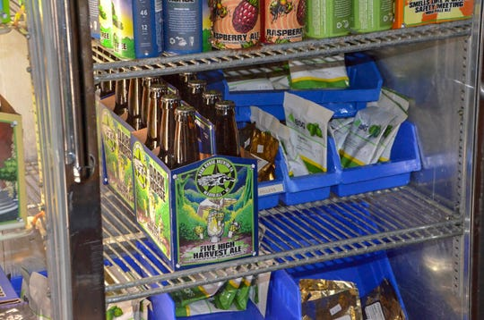You can buy Five High Harvest Ale, which is made with High Five Hop Farm hops, at the Dark Horse Brewing Co. general store or on tap at the taproom.