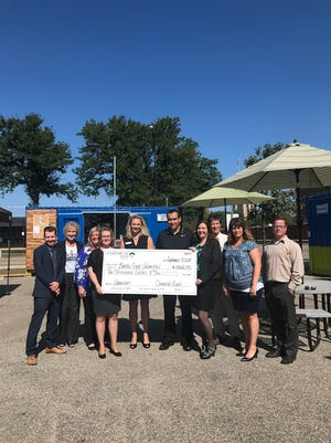 (From left) Josh Pompey, Valerie Byrnes, Kara Beer, Sarah Russell, Sara Wallace, Devon Gibson, Renee Underwood, Ted Dearing, Tami Pitale and John Hart attend the check presentation ceremony to celebrate Chemical Bank's investment in the new Small Business - Community Loan and Grant Fund on Sept. 13, 2018.