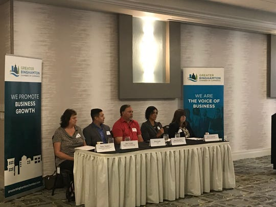 A panel addresses concerns regarding Paid Family Leave and bereavement to members of the Greater Binghamton Chamber of Conference on Tuesday.