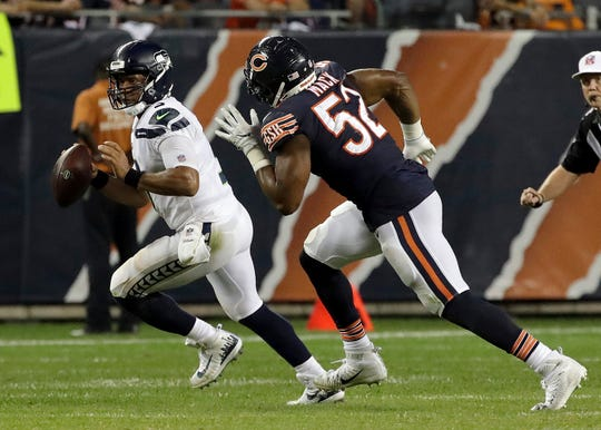 Chicago Bears linebacker Khalil Mack (52) chases Seattle Seahawks quarterback Russell Wilson (3) during the second half of Seattle's loss on Monday.