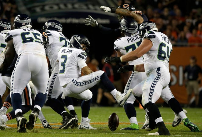 Seahawks quarterback Russell Wilson (3) loses a ball during the first half of Monday's loss to Chicago.