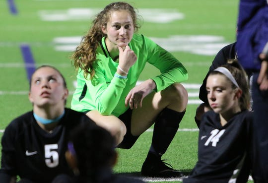 South Kitsap goalkeeper Megan Nail takea a break with her team at halftime during a game against Olympia. Nail's wing span and booming kicks make her a college prospect. She's committed to the University of San Francisco.