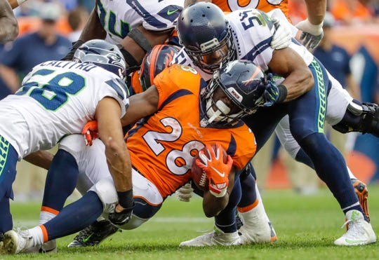 Bobby Wagner (left) was injured during a Sept. 9 game against Denver. He was replaced in Monday's game by backup Austin Calitro, whose play was praised by Seahawks coaches.
