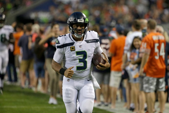 Seahawks quarterback Russell Wilson takes the field before Monday's loss in Chicago. Wilson suffered a hamstring injury during the game but expects to play Sunday against the Cowboys.