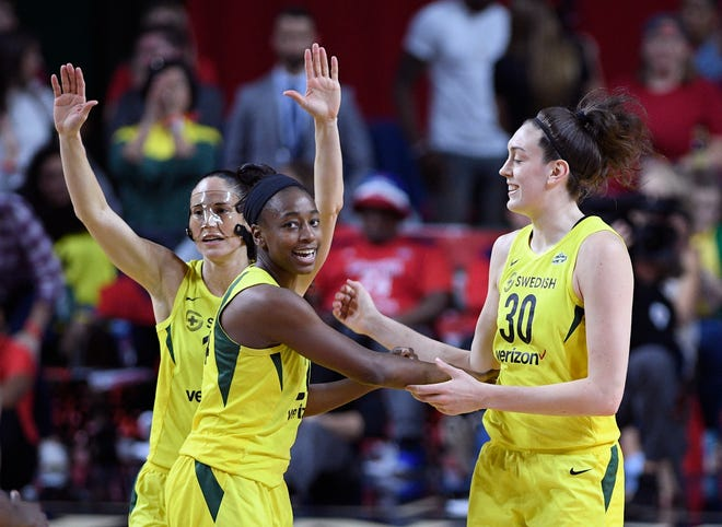 From left, Sue Bird, Jewell Loyd and Breanna Stewart celebrate during the first half of Game 3 of the WNBA finals last week in Virginia. The trio led the Seattle Storm to the championship, defeating the Washington Mystics in the finals. Now all three are part of the U.S. team for the FIBA Women's World Cup. The tournament begins Saturday in Spain.