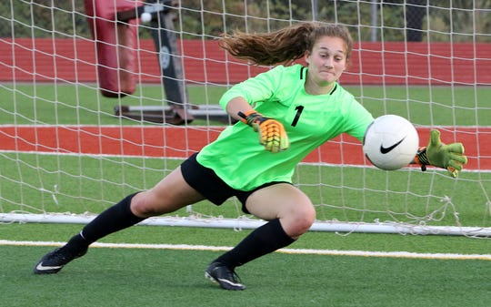 South Kitsap goalkeeper Megan Nail practices her stops during warm-ups before a game against Olympia.