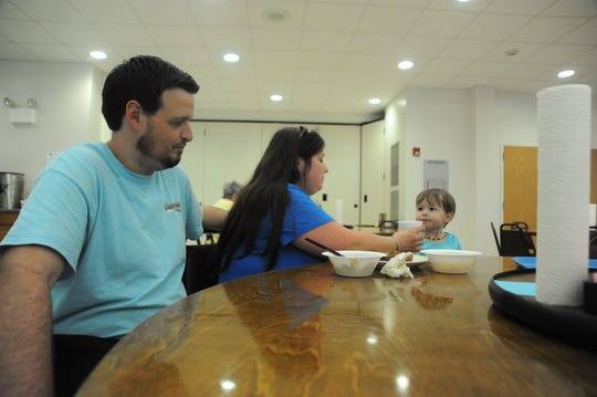 Keith and Nada Jackson eat lunch with their son Travis in the Spearman Dining Hall at Christmount on Sept. 19. The Jacksons fled New Bern the day before Hurricane Florence made landfall and were among the nearly 100 people who took advantage of the Black Mountain conference center's offer of free rooms and food for evacuees.