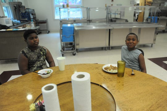 Eleven-year-old Cornelius Bell, left, and his seven-year-old brother Jeiel, fled their home in Whiteville with their mother, younger sister, aunt and cousins, ahead of Hurricane Florence.