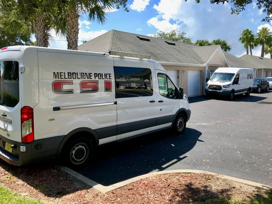 Two white Melbourne Police Department CSI vans and FBI agents parked alongside a row of garages on Tucan Way within the Cypress Springs neighborhood. It was not immediately known if the FBI presence at the complex was connected to the incident at the airport.