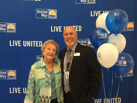 Dot Nelson, left, and Rob Rains, president of United Way of Brevard, pose for a photo during the United Way's annual campaign kickoff Thursday. Nelson's husband, the late John Nelson, was president of the nonprofit before Rains.