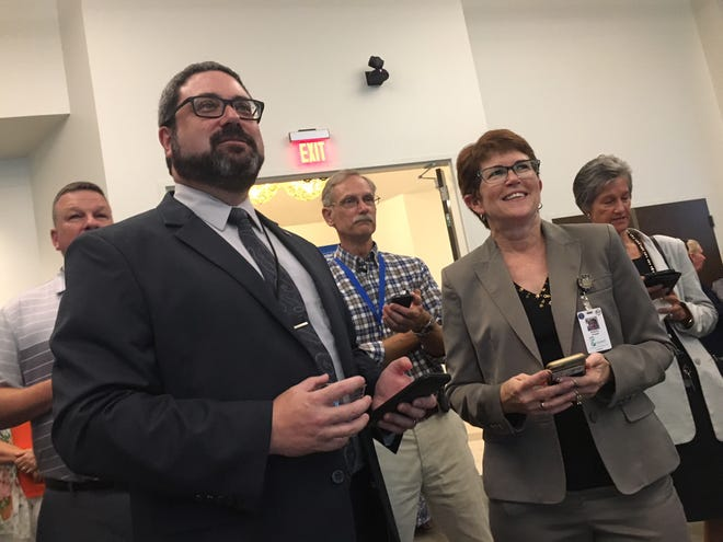 Brevard Housing and Human Services Director Ian Golden, left, and Emergency Management Director Kimberly Prosser Kimberly Prosser, right, foreground, test their United Way knowledge during a smartphone-based trivia game at the United Way's campaign kickoff Thursday.