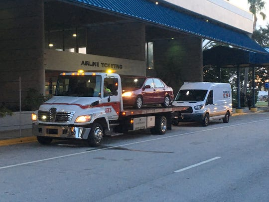 Orlando Melbourne International Airport was on lockdown Sept. 20, 2018, after a security breach. Shown is the Melbourne Police Department's crime scene van and a suspect's car.