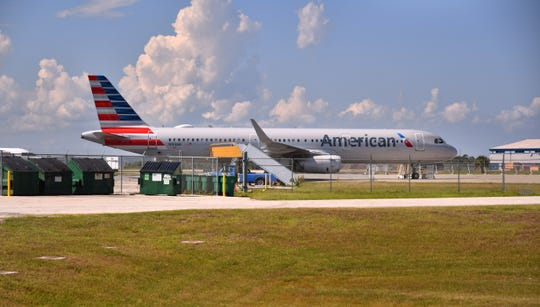 The American Airlines A321  parked near a  hangar at Orlando Melbourne International Airport  that a Florida Tech flight student entered early Thursday morning. The student, left his car running, hopped the fence, and entered the plane where he was met by two employees.
