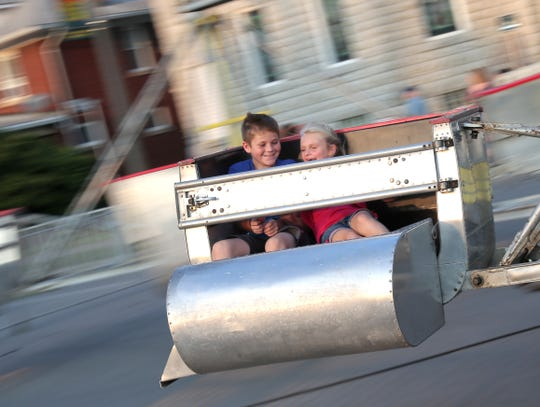 Dawson Hefner, 10; and his sister, Remington, 7; enjoy a ride during the 2018 Crestline Harvest Festival. This year's festival starts Sept. 19.