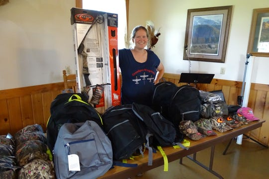 Ruth Malpas of Elkhorn Lake Hunt Club stands with a few door prizes that will be available for children during the Family Fun Day on Sept. 29.