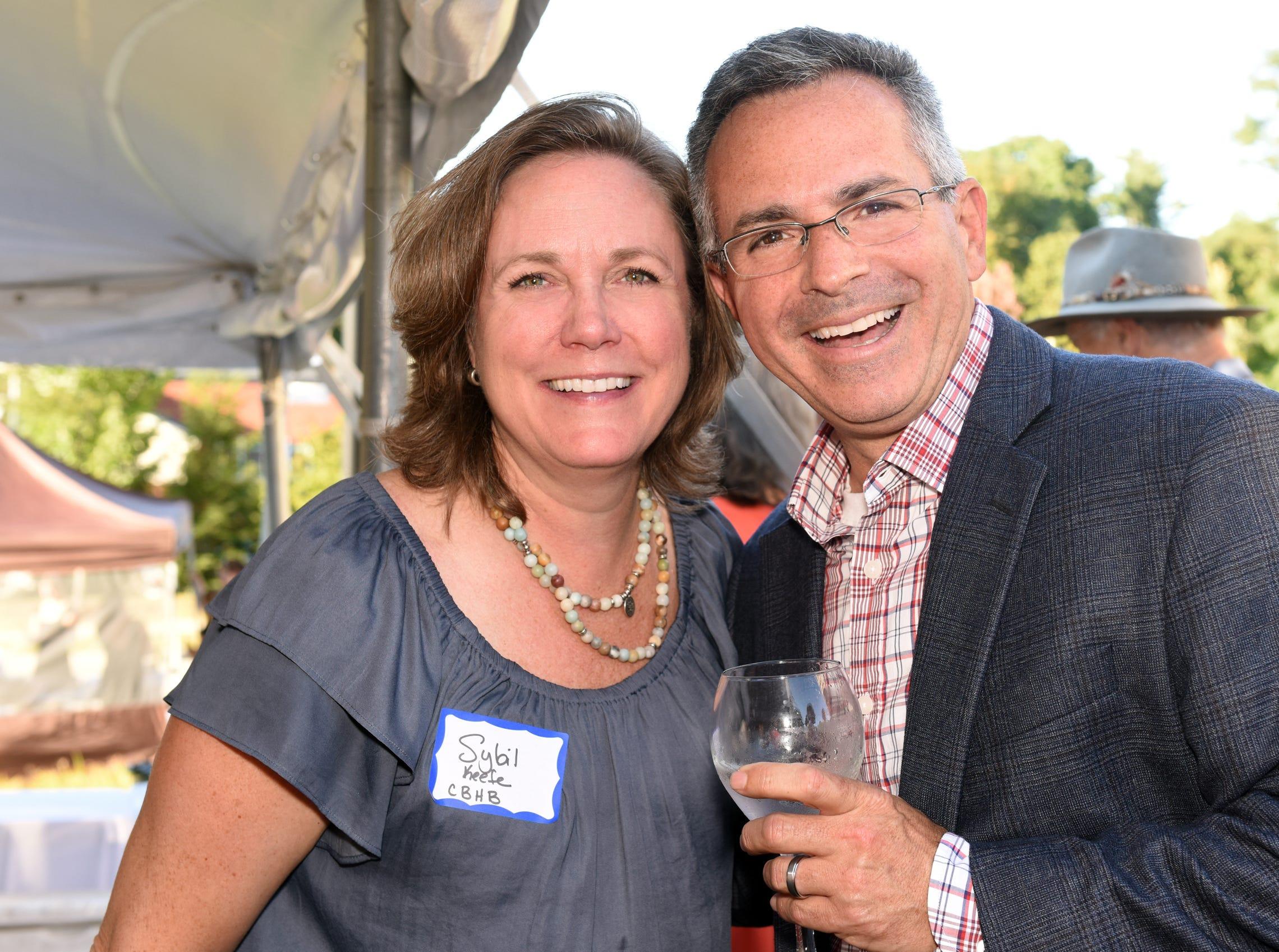 Sybil Keefe, director of marketing for Coldwell Banker Hickok & Boardman Realty, poses with Burlington Free Press President Jim Fogler at Hickok & Boardman's 60th anniversary celebration on Sept. 13, 2018, in Burlington.