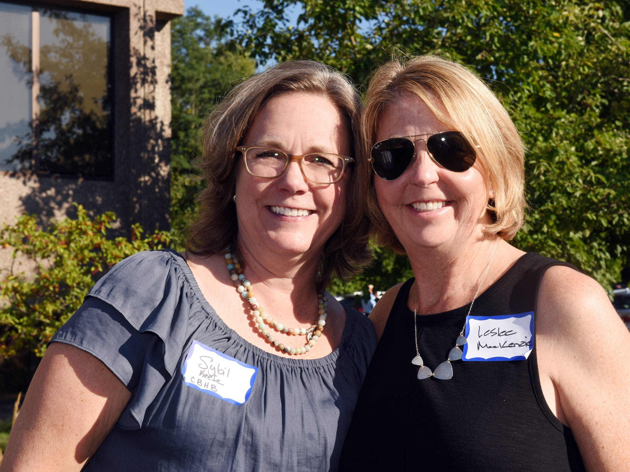 Leslee MacKenzie and Sybil Keefe pose at the 60th anniversary celebration for Coldwell Banker Hickok & Boardman Realty on Sept. 13, 2018, in Burlington.