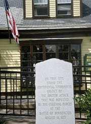 A stone marker outside the visitor center at the  Bennington Battle Monument commemorates the Battle of Bennington of Aug. 16, 1777.