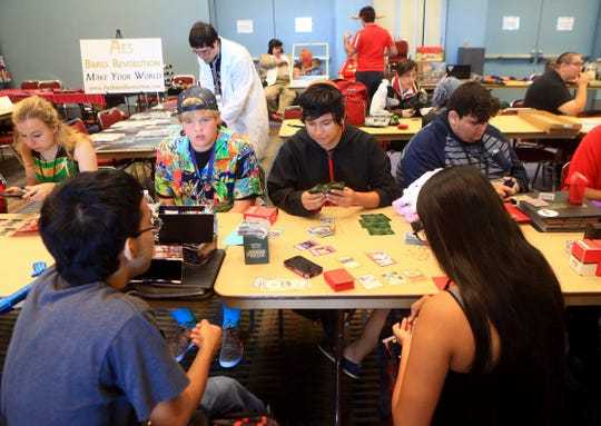 Gamers play a card game of Pokemon during the Realms Con on Saturday, Oct. 3, 2015, at the American Bank Center in Corpus Christi.