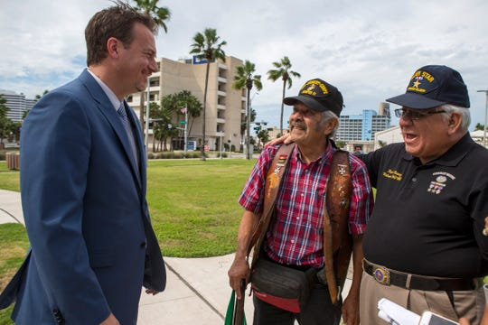 Congressman Michael Cloud (from left), Marine Cpl. Ricardo Gonzalez and Ram Chavez talk before a ceremony at Sherrill Park on Thursday, Sept. 20, 2018 during which Gonzalez received medals earned but had not received due to an administrative error. He was honorably discharged from the Marines in 1970. With the help of Cloud's district office, the errors were corrected.