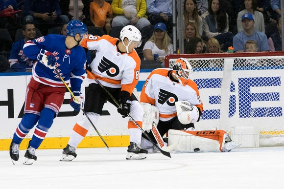 Brian Elliott (37) and defenseman Robert Hagg (8) tend the net against New York Rangers right wing Pavel Buchnevich (89) during the first period Wednesday.
