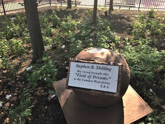 A memorial garden to the late founder of the Camden Riversharks is vandalized and trash-strewn at Campbell's Field in Camden.