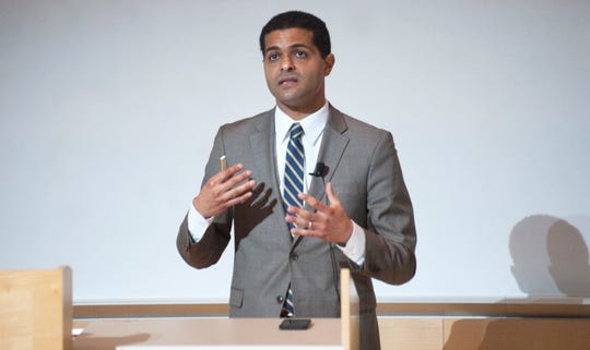 N.J. Department of Health Commissioner Dr. Shereef Elnahal delivers a presentation on the benefits of medical marijuana to doctors and medical students at Cooper Medical School of Rowan University in Camden on Thursday, September 20, 2018.