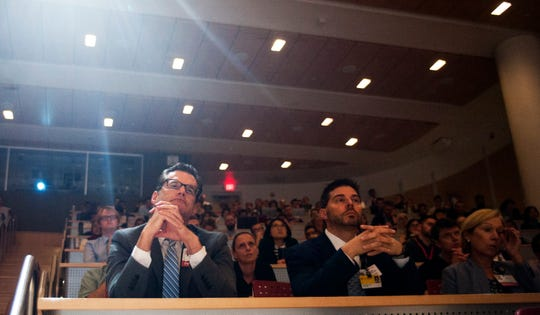 Doctors and medical students listen as N.J. Department of Health Commissioner Dr. Shereef Elnahal delivers a presentation on the benefits of medical marijuana at Cooper Medical School of Rowan University in Camden on Thursday, September 20, 2018.
