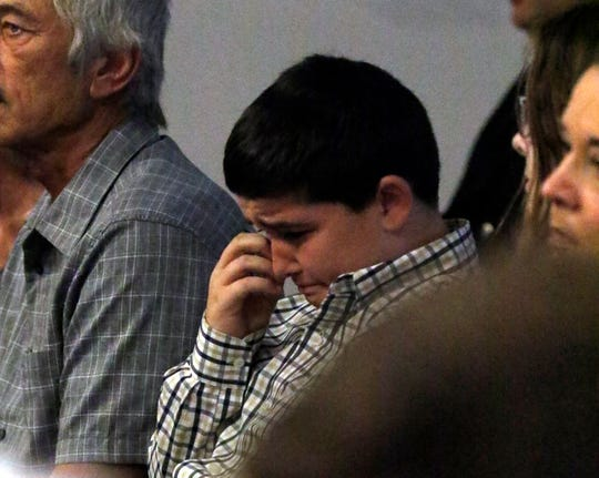 Adam Liste, Joe Patterson's stepson, wipes a tear from his eye during an awards ceremony Thursday, Sept. 20, 2018, at the State Fire Marshal's Office in Reynoldsburg. Patterson - who died June 24 from injuries he received while working with compressed air cylinders at Paint Creek Joint Fire District - was honored at the ceremony.