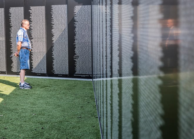 Roger Peppers from Circleville studies the names on the American Veterans Traveling Tribute Vietnam Wall at the VA Memorial Stadium on September 20, 2018. While Peppers did not go to Vietnam, he was in the Army during the time. The wall will be inside the stadium until Sunday.