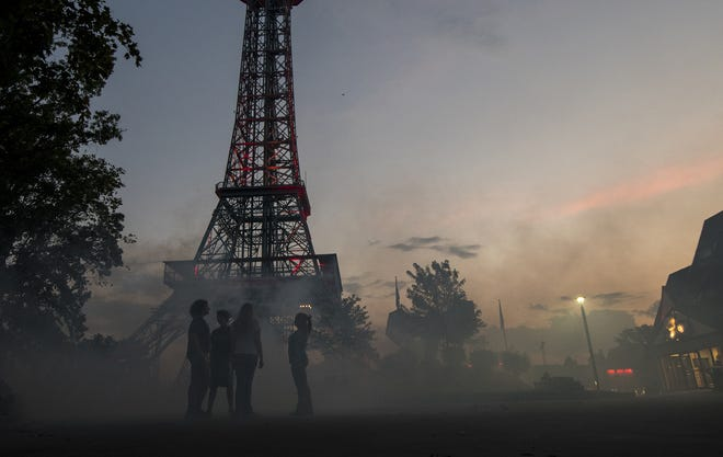 A group of teens stands in the fog under the iconic King's Island tower during the Halloween Haunt dry run.