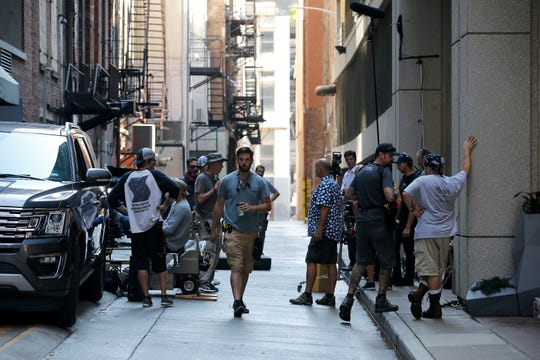 The crew and cast between filming scenes of 10 Minutes Gone in Benham Alley Thursday, September 20, 2018. The movie stars Bruce Willis.