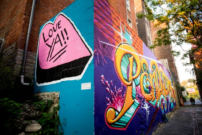"""""""Love Ya!!"""" designed by Leon Reid IV is featured in Bolivar Alley in Pendleton as part of New Lines Alleyway Murals: Phase II by ArtWorks."""