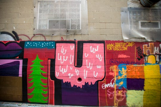 ÒSolidarityÓ designed by Girl Mobb & Graffiti Camp for Girls is featured in Bolivar Alley in Pendleton as part of New Lines Alleyway Murals: Phase II by ArtWorks.