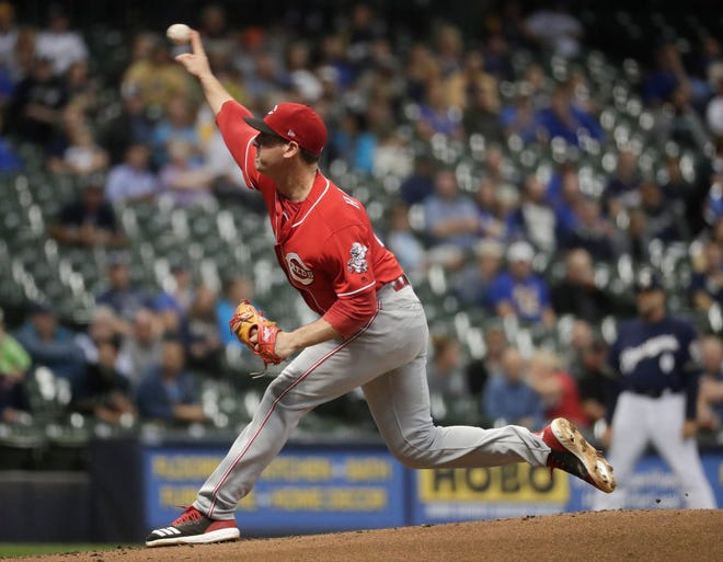 Cincinnati Reds starting pitcher Matt Harvey throws during the first inning of a baseball game against the Milwaukee Brewers Wednesday, Sept. 19, 2018, in Milwaukee.