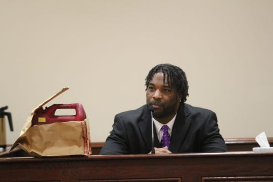 Kellum Williams testifies about Amy Murphy's slaying, while the fuel can used to douse her with gas sits beside him on the stand.