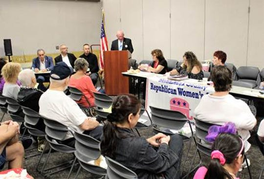 Peter Pisar (center at podium) speaking before the group at the Middlesex County Republican Women's Club.