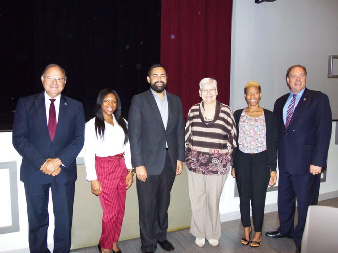 Joining recent graduates of the Union County Non-Profit Leadership Fellows Institute Jasmine Coleman (second from left) and Tyechia Wade (second from right), both from Community Access Unlimited (CAU), were (left to right) Union County Freeholder Angel Estrada, Freeholder Chairman Sergio Granados, CAU's Joanne Oppelt and Freeholder Bruce Bergen.