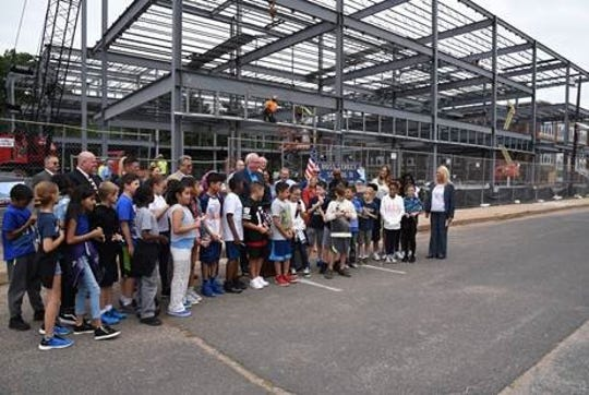 The township and school district marked a milestone in the construction of the new$30 millionRoss Street School #11 in downtown Woodbridge.