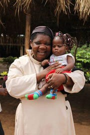 Sister Jane Mankaa and one of the orphans from The Good Shepherd Home for Children in Cameroon.