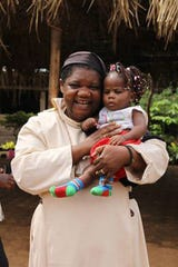 Sister Jane Mankaa and one of the orphans fromThe Good Shepherd Home for Children in Cameroon.