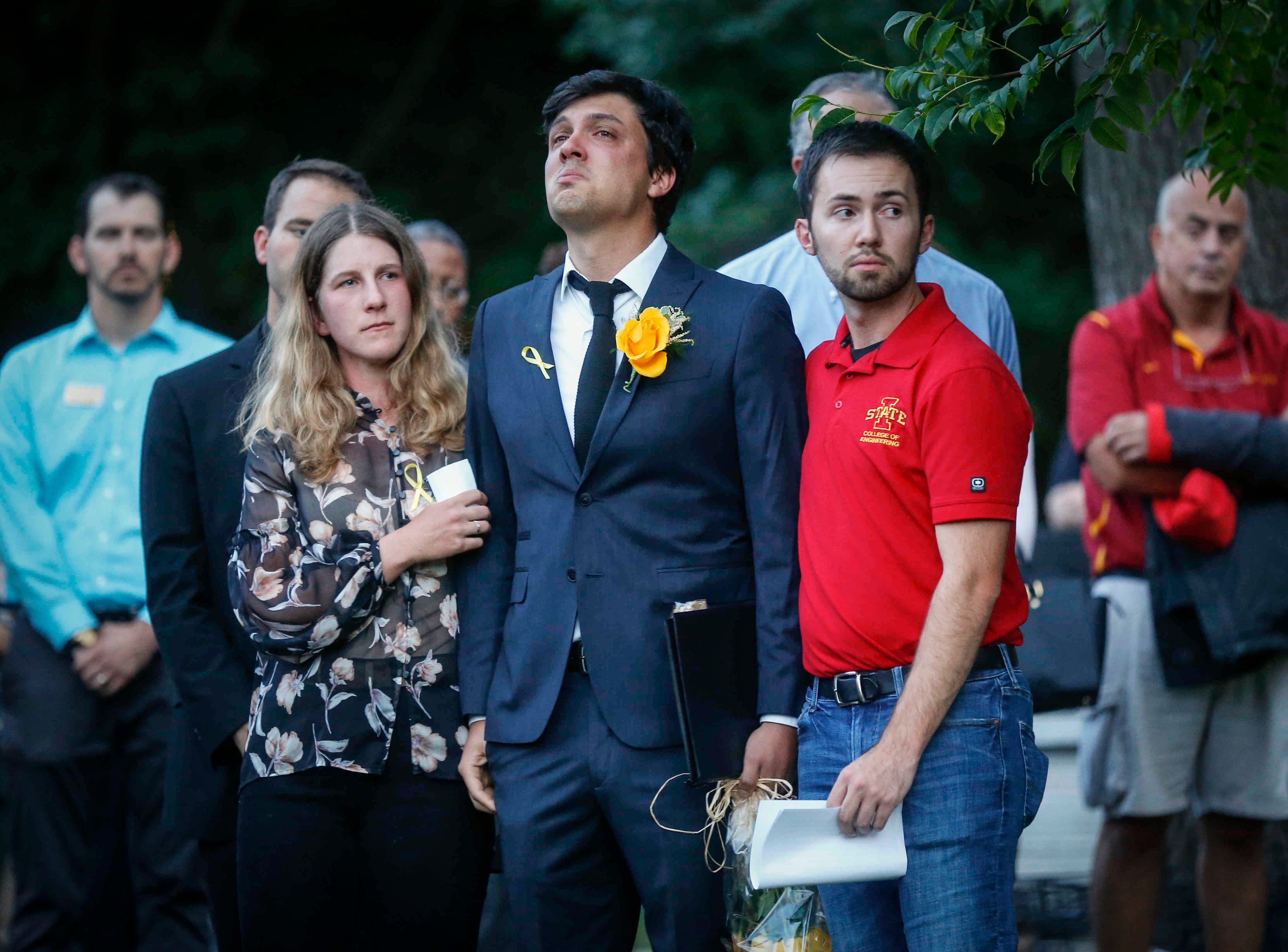 Carlos Negrin Bola–os, boyfriend of Iowa State student Celia Barquin Arozamena, fights his emotions as students, faculty and community members mourn Arozamena during a vigil on Wednesday, Sept. 19, 2018, in Ames.