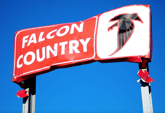 The Falcon Country sign, which survived the 2008 tornado that struck Parkersburg, still stands over the entrance to Aplington-Parkersburg's football stadium.