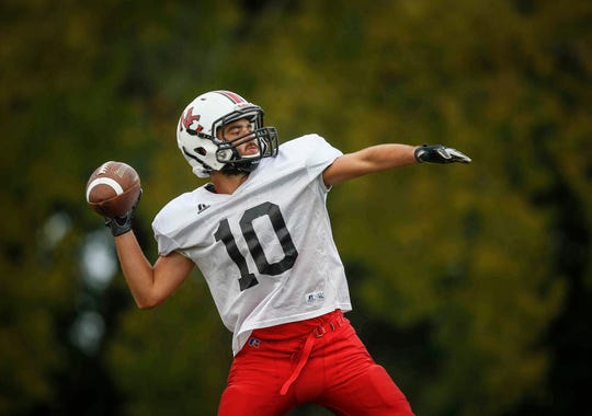 Mason City senior receiver Seth Drumheller throws the ball during football practice on Tuesday, Sept. 18, 2018, in Mason City. Drumheller has been battling Leukemia since his freshman year, and was recently cleared to play football.