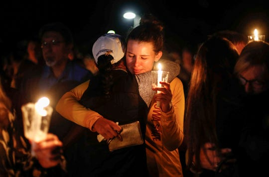 Iowa State students, friends and former golf teammates of Celia Barquin Arozamena mourn their fellow student during a vigil on Wednesday, Sept. 19, 2018, in Ames.