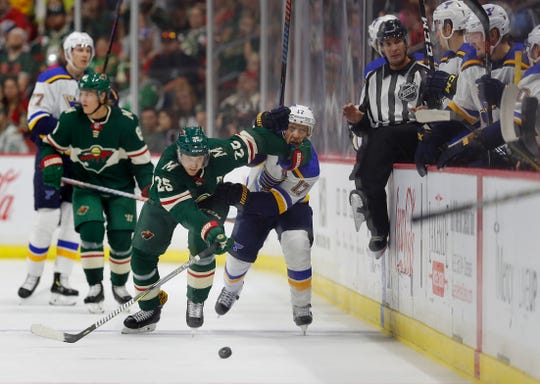 Minnesota Wild defenseman Jonas Brodin, left, beats St. Louis Blues left wing Jaden Schwartz, right, to the puck along the boards during the first period of an NHL preseason hockey game, Wednesday, Sept. 19, 2018, in Des Moines, Iowa.