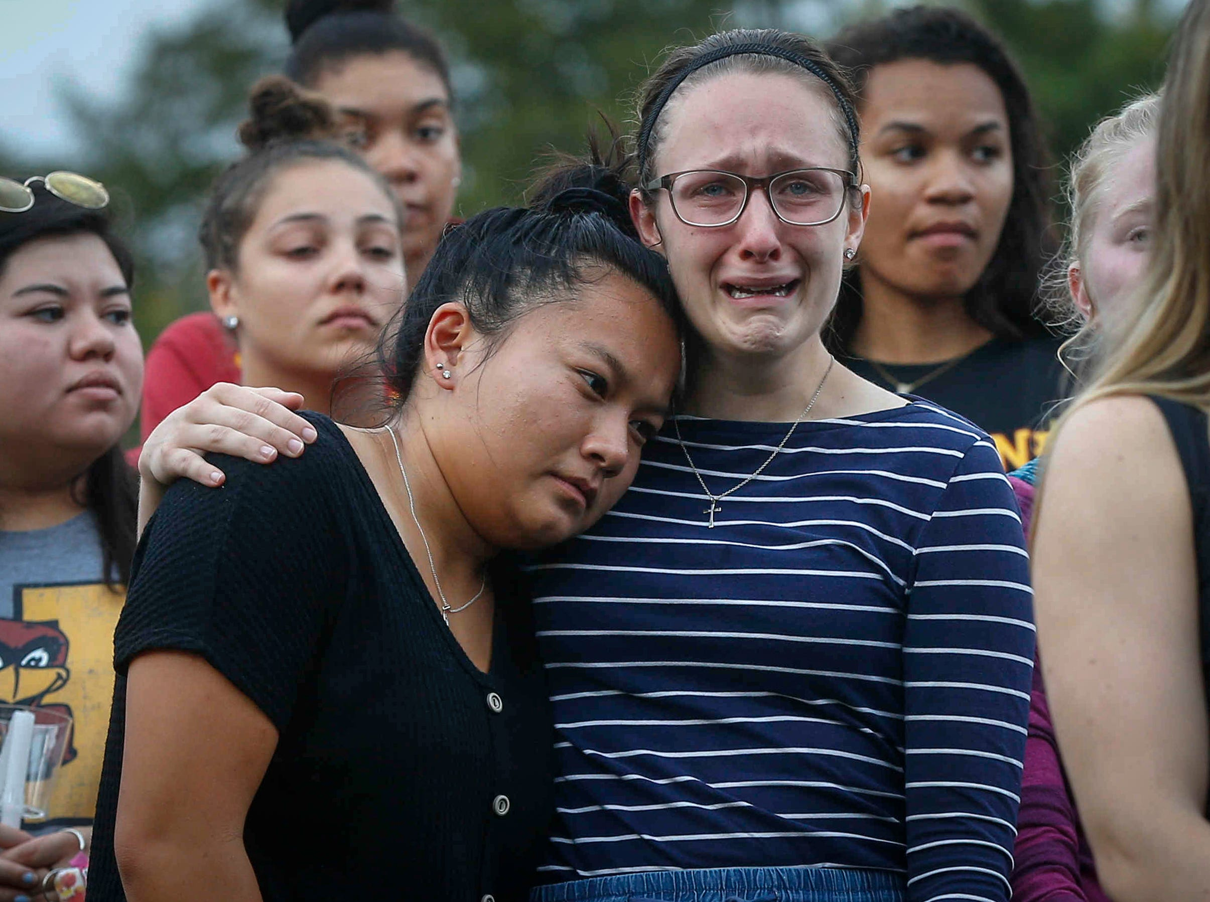 Iowa State students and friends of Celia Barquin Arozamena succumb to emotions during a vigil on Wednesday, Sept. 19, 2018, in Ames.